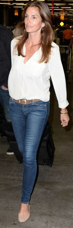 Who made Cindy Crawford's blue skinny jeans, gold watch, and nude scallop ballet flat shoes?