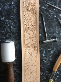 Hand tooled guitar strap with a floral pattern. Work in progress. Flowers.