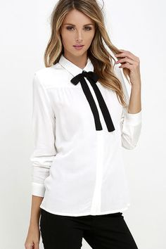 Take your look to whole new heights in the High Society Ivory Long Sleeve Button-Up Top! Soft woven shirt includes long sleeves with button cuffs while a hidden full-length button placket runs down the straight-cut silhouette. Classic collar is accented by a chic black tie, secured by a concealed button at back.