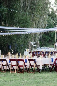 Elegant outdoor reception decor idea - family-style table with pink table linens and string lights {Tina Sargeant Photography}