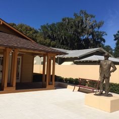 """A statue of Frank Lloyd Wright stands in front of the visitor's center at Florida Southern College, where visitors can learn about his """"Child of the Sun"""" series of buildings on the campus."""