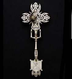 Africa | Processional hand cross from Ethiopia | Silver | 19th century | Length 27cm