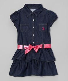 Get an extra touch of girlishness with this twist on a classic denim button-up. The collar and front buttons give the top a polished look, while the bright pink ribbon belt, puff sleeves and tiered ruffle skirt lend the perfect pinch of feminine flair. Includes dress and belt80% cotton / 18% polyester / 2% spandexMachine...