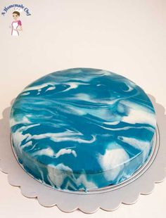 This chocolate mousse cake with chocolate torte insert dressed with mirror glaze is an absolute treat if one wants to show off dessert making skills by Veena Azmanov