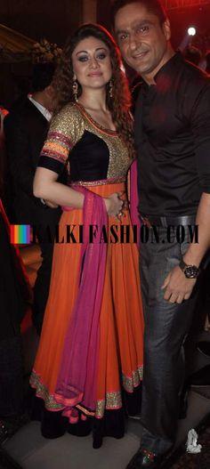 http://www.kalkifashion.com/ Shefali Zariwala in orange anarkali suit with husband at Ravi Dubey and Sargun Mehta's reception bash.