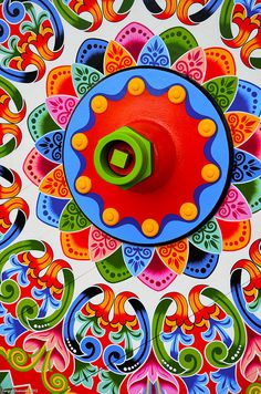 Oxcart wheel of blue, green, red, orange & pink- Sarchi, Costa Rica