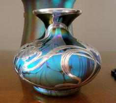 This vase is an exceptional and fine example of Loetz. Description from vasekino.net. I searched for this on bing.com/images