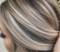 Cool ash blonde against a neutral brown