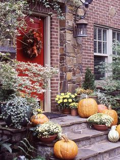 I'm looking for some fall decor for my front door and porch which, like this one, has no roof to protect the decorations.  Obviously, the pumpkins and mums are weather-proof but I'm still looking for a wreath ....