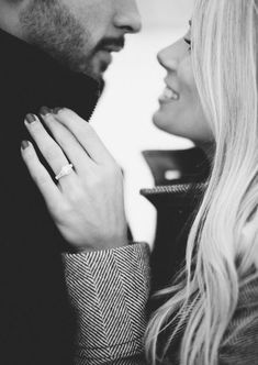 This engagement photo is simple, elegant and classic in black in white. Plus it shows off the engagement ring!