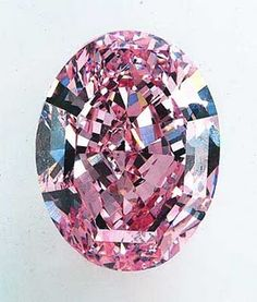 "The Noor-ul-Ain or ""the light of the eye"" is a pale pink, oval brilliant-cut stone, weighing around 60 carats diamond."