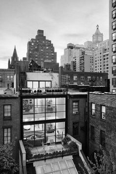 grand designs. new york. loft apartment. glass. black and white.