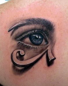 This artistic tattoo combines a realistic eye and graphic of the Eye of Horus patterns.