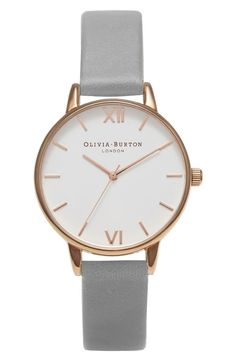 Delicate hands and polished stick indexes adorn the milky-white dial of this gleaming round watch balanced on a lightly textured leather strap.