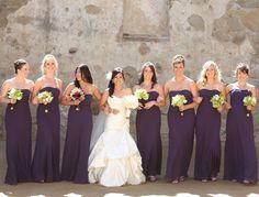floor-length purple bridesmaid dresses + green/yellow bouquets