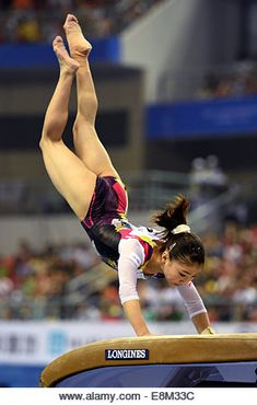 Nanning, China's Guangxi Zhuang Autonomous Region. 10th Oct, 2014. Asuka Teramoto of Japan performs on the vault - Stock Image