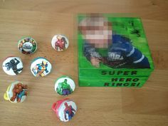 My three year old grandson wanted super hero rings from the super hero ring store! I found some flat faced ones in party favors at Dollar Tree (they were roulette wheels) and a small wooden box. I found some super hero stickers at Michaels, stuck them on the rings, painted the box his favorite color, put his picture on it, then used lots of mod podge! It is far from perfect, but he loved them!