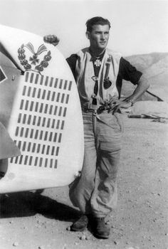 Luftwaffe pilot Heinrich Bartels poses next to the rudder of his Bf109 G-6 fighter plane in the Hasani aerodrome in Kalamaki, Greece on Nov 17, 1943. The marks on the rudder indicate 70 aerial combat victories. Bartels' official record was 99 victories, both on the Eastern Front and over Germany. Bartels was shot down by a US plane on Dec 23, 1944. The wreck of his fighter and his remains weren't discovered until Jan 26, 1968 near the town of Meckenheim, Germany.