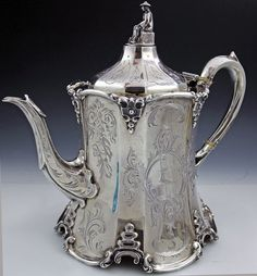 English Silver Antique Teapot: Hand engraved by William Smily dated & hallmarked London 1858.