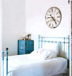 A rustic little cottage painted out in white with gorgeous little touches of aqua-blue & duck-egg blue