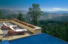 THIS IS WILDFLOWER HALL IN THE HIMALAYAS NEAR SHIMLA--INDIA THE HOTEL HAS COLONIAL-ERA DECOR AND A BREATHTAKING VIEW OF THE NEARBY HIMALAYAS.