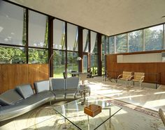 "Architect: Philip Johnson Year: 1952 In the structure Johnson called the ""glass prism,"" the home's living space features a freestanding circular fireplace."