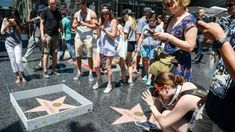 Apparently, Donald Trump has a Hollywood Walk of Fame star. Alrighty then. Delighted to see that street artist Plastic Jesus decorated Trump's Hollywood star with a six-inch wall complete with teeny tiny barbed wire, a miniature American flag and. Hollywood Star, Hollywood Walk Of Fame, What Is Street Art, Plastic Jesus, Famous Street Artists, Trump Wall, Tall Greys, Hollywood Boulevard