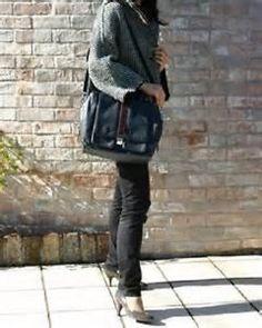 Botkier black and chocolate Gabriel shoulder bag, as seen on many fashionistas. Retailed $565  Find it on Ebay: http://www.ebay.com/itm/565-NWT-BOTKIER-GABRIEL-LEATHER-SHOULDER-HANDBAG-PURSE-BAG-BLACK-/331001989831?ssPageName=STRK:MESE:IT