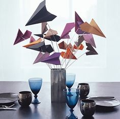 Paper plane centerpieces, could be done with the oragami cranes too!