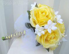 Silk Wedding bouquet Yellow rose Bridal Bouquet White tulle & Pearl Stephanotis. $85.00, via Etsy. - Bridesmaids?