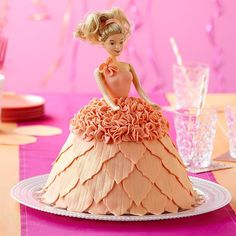 Make a little girl's birthday party unforgettable with this dazzling doll cake! It's easy to create the flowing dress shape with the Wonder Mold pan. The petal-like trim is made using Decorator Preferred Fondant and Geometric Fondant Cut-Outs.