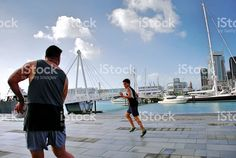 Playing Rugby against an Urban Auckland Scene, New Zealand royalty-free stock photo Royalty Free Images, Royalty Free Stock Photos, The World Race, Interracial Marriage, Island Man, Kiwiana, Boys Playing, Auckland, Getting Out