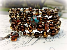 Copper and Browns Hand Beaded Memory Wire Bracelet by Brandi by InFaithJewelry on Etsy