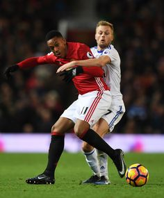 Anthony Martial of Manchester United is challenged by Sebastian Larsson of Sunderland during the Premier League match between Manchester United and Sunderland at Old Trafford on December 26, 2016 in Manchester, England.