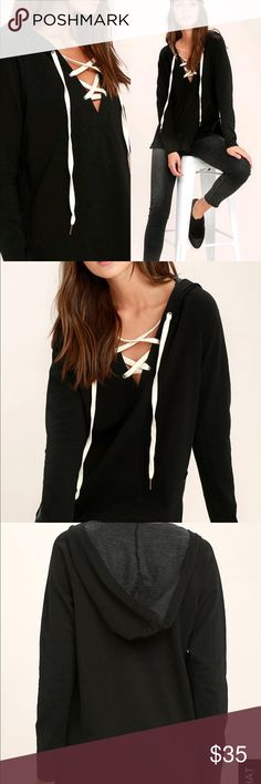 """Project Social T Bali Black Hoodie Some days just call for yoga pants and the Project Social T Bali Black Lace-Up Hoodie! This medium-weight knit hoodie has cream laces at the neckline, long sleeves, and oversized hood. Relaxed bodice has side slits and high-low hem. Unlined. Top measures 2"""" longer at back. 84% Cotton, 12% Polyester, 4% Spandex. Machine Wash Cold. Made with Love in the U.S.A. Project Social T Tops Sweatshirts & Hoodies"""