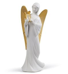 01007728  CELESTIAL MELODY (TREE TOPPER) (RE-DECO)   Issue Year: 2012  Sculptor: Francisco Cuesta  Size: 21x9 cm