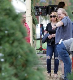 First look of Mariah Carey's Cincinnati-shot film: Mariah Carey, who is directing a Christmas-themed film in Wyoming, consults with Jeff Barklage, director of photography on the Village Green where a scene from the movie will be shot. The Enquirer/Patrick Reddy