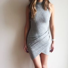 "[grey marled sleeveless draped mini dress] [Please don't purchase this listing as I will make a new one for you] A beautiful grey draped sleeveless dress.Finely ribbed marled texture.Super comfy and stretchy! Fits like a glove, extremely form fitting. You will look smoking in this! Lined. 64% rayon, 32% polyester, 4% spandex. Size S (modeled)- 36"" long, 13"" laying flat pit to pit. I am 5""8. Has stretch. Doesn't come with tags as it was purchased directly from the vendor--they are COMPLETELY…"