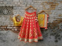 Banarasi silk orange lehenga with yellow blouse and dupatta and pearl work. By Amrita Thakur. Half saree/ ghahra/ langa oni
