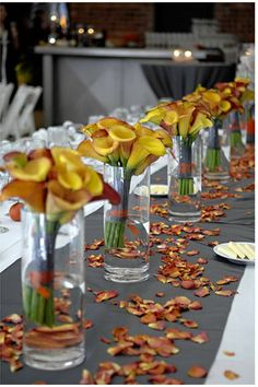 Need to ask the florist about orange flower petals on the tables if I do gray napkins....