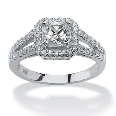 Mega-bright 1.63 carats T.W. of cubic zirconia ignite this princess-cut ring with spectacular sparkle, while round cubic-TPxFEuTc