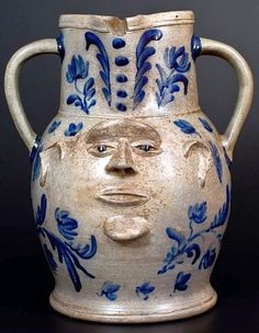 Phenomenal Face Vessel. Important and Probably Unique Large-Sized Stoneware Two-Sided Face Pitcher with Profuse Cobalt Floral Decoration, attributed to Elisha B. Hyssong, Cassville, PA, circa 1850.