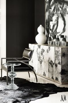 Elevate your living space with this Barhide Console by Bernhardt. Top with a full bar set or a white statement vase.