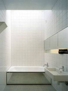 Be inspired by your tiles! We love this geometric, minimal bathroom design with bath mirror Minimal Bathroom, White Bathroom, Small Bathroom, Small Bathtub, Bathroom Ideas, Bath Ideas, Bathroom Organization, Bathroom Designs, Master Bathroom
