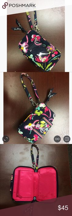 All-in-one Vera Bradley Wristlet This all-in-one wristlet has many different benefits. It is a phone holder. My 5S fits with room, so I believe it would also hold a 6, 6s, and 7. This is also a wallet. Inside the zippered section, there are many pockets for money and cards. Lastly, there is a windowed section for your ID to easily flash when needed. Strap has a clip, so you can easily clip on to backpack or anything else. Vera Bradley Bags Wallets