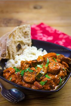 Eggplant, red kidney beans and courgette/zucchini doused in a luscious, rich, creamy and amazingly flavoursome vegan homemade tikka masala curry sauce.