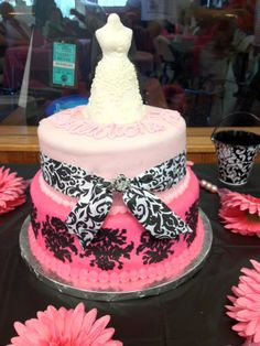 Pink damask shower cake - Pink and black damask wedding shower cake....my third attempt at stacking cakes and I think I'm finally getting the hang of it!     Cricut cake and Wilton sugar sheets used for the designs on the first tier.     Wedding dress is hang sculpted from fondant.