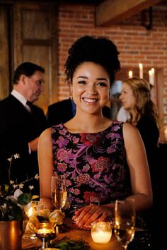 Beth Kingston wearing an Alice + Olivia floral dress on Chasing Life