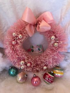 50s True Vintage PINK 15inch Bottlebrush Christmas Wreath- silver glass ball picks,, original pink ribbon bow. 15 inches by CowgirlPoetry on Etsy https://www.etsy.com/listing/473316924/50s-true-vintage-pink-15inch-bottlebrush