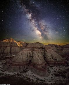 Impressive: Mr Black said his images help to remind him how small he is. Pictured: The glorious night sky in Badlands, South Dakota.